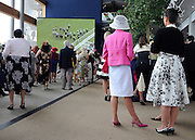 © licensed to London News Pictures. ASCOT, UK.  16/06/11. Women watch the races indoors on a big screen. Ladies Day at Royal Ascot 16 June 2011. Royal Ascot has established itself as a national institution and the centrepiece of the British social calendar as well as being a stage for the best racehorses in the world. Mandatory Credit Stephen Simpson/LNP