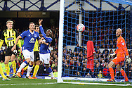 Arouna Kone of Everton (c) heads the ball and scores his teams 1st goal as Dagenham & Redbridge goalkeeper Mark Cousins looks on. The Emirates FA cup, 3rd round match, Everton v Dagenham & Redbridge at Goodison Park in Liverpool on Saturday 9th January 2016.<br /> pic by Chris Stading, Andrew Orchard sports photography.