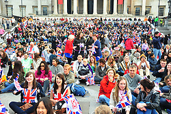 Trafalgar Square London , UK  29/04/2011. The Royal Wedding of HRH Prince William to Kate Middleton. 8am crowds await the big moment . Photo credit should read ALAN ROXBOROUGH/LNP. Please see special instructions. © under license to London News Pictures