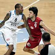 Anadolu Efes's Terence Kinsey (L) and Erdemir's Altan Erol (C) during their Turkish Basketball League match Anadolu Efes between Erdemir at Arena in Istanbul, Turkey, Wednesday, January 28, 2012. Photo by TURKPIX