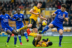 January 19, 2019 - Wolverhampton, England, United Kingdom - Raul Jimenez of Wolverhampton Wanderers watched on by Leander Dendoncker of Wolverhampton Wanderers and Wilfred Ndidi of Leicester City as \l15 attempts to gather the ball during the Premier League match between Wolverhampton Wanderers and Leicester City at Molineux, Wolverhampton, UK. On Saturday 19th January 2019. (Credit Image: © Mark Fletcher/NurPhoto via ZUMA Press)