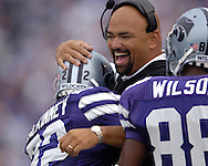 Kansas State head coach Ron Prince hugs Wildcat Justin McKinney (22) after McKinney's 88-yard opening Kick-Off touchdown return against Florida Atlantic at Bill Snyder Family Stadium in Manhattan, Kansas, September 9, 2006.  The Wildcats beat the Owls 45-0.