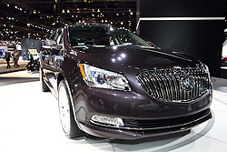 12 February 2015:  2015 BUICK LACROSSE: Buick's popular LaCrosse four-door midsize sedan offers contemporary interior and exterior design cues, advanced safety technologies and enhanced in-vehicle connectivity. For MY2015, OnStar with 4G LTE and standard built-in Wi-Fi hotspot is available, as is a standard rearview camera system, new four-way-adjustable front-seat headrests, and Intellilink enchancements including Text-messaging alerts and SiriEyes Free. Fresh paint colors include White Frost Tricoat, and two metallic, Deep Garnet and Dark Chocolate.  Front styling feature signature wing-shape LED daytime running lamps and LED wraparound taillamps, which are complemented by the waterfall grille and sculpted exterior panels. The LaCrosse is available in five trim levels that include the LaCrosse Base (1SB), Leather (1SL), Premium (1SP), Premium II (1SR) and Touring (1ST). Offered in front-wheel-drive and all-wheel-drive models, consumers have two efficient engines choices: the standard 182 horsepower 2.4-liter four-cylinder; and an available 3.6L V-6 that deliver 303hp and have E85 ethanol FlexFuel capability. Both engines are mated to efficient six-speed transmissions, and the maximum trailer towing is 1000 pounds. Consumers have a choice of front-wheel and all-wheel drive configurations. The five-passenger cabin has new seats, enhanced materials, redesigned central instrument panel and console, an all-new, available Ultra Luxury Interior Package and next-generation IntelliLink infotainment system, with intuitive controls and natural voice recognition. For shopping and travel, the trunk provides 13.3 cubic foot of luggage room.<br /> <br /> First staged in 1901, the Chicago Auto Show is the largest auto show in North America and has been held more times than any other auto exposition on the continent. The 2015 show marks the 107th edition of the Chicago Auto Show. It has been  presented by the Chicago Automobile Trade Association (CATA) since 1935.  It is held at M