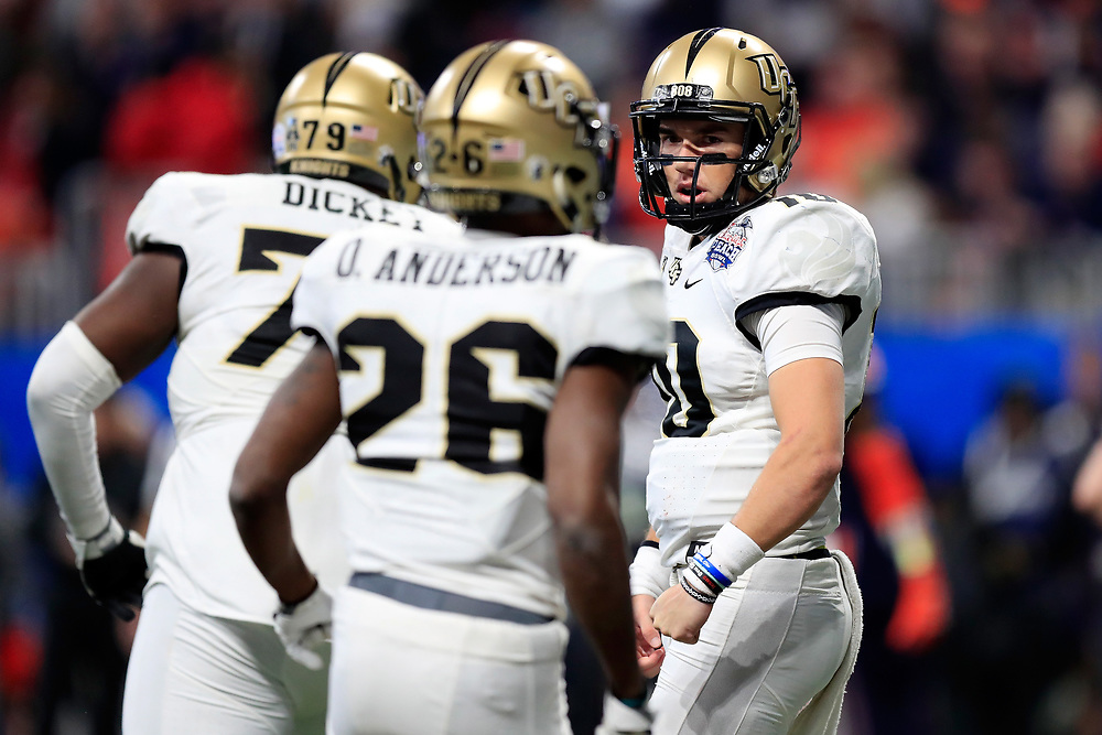 UCF Knights quarterback McKenzie Milton (10) reacts to a play during the 2018 Chick-fil-A Peach Bowl NCAA football game against the Auburn Tigers on Monday, January 1, 2018 in Atlanta. (Paul Abell / Abell Images for the Chick-fil-A Peach Bowl)