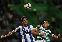April 18, 2018 - Lisbon, Portugal - Porto's Spanish defender Ivan Marcano (L) vies with Sporting's midfielder Rodrigo Battaglia from Argentina (R ) during the Portugal Cup semifinal second leg football match Sporting CP vs FC Porto at the Alvalade stadium in Lisbon on April 18, 2018. (Credit Image: © Pedro Fiuza/NurPhoto via ZUMA Press)