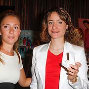NLD/Ridderkerk/20120911 - Presentatie magazine Helden, Deborah Leeser en Marianne Vos met haar briljanten ketting