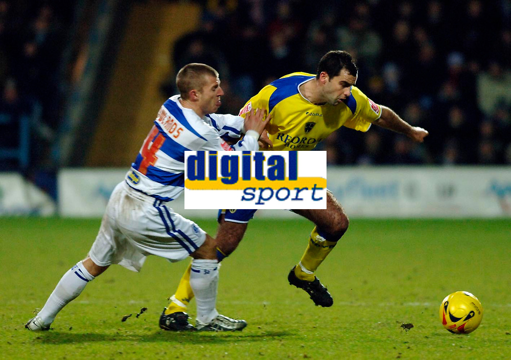 Photo: Daniel Hambury.<br />Queens Park Rangers v Cardiff City. Coca Cola Championship. 28/12/2005.<br />Cardiff's Chris Barker (R) and QPR's Martin Rowlands battle for the ball.