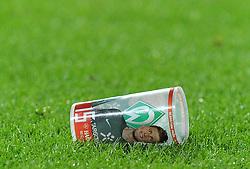 29.04.2011, Weserstadion, Bremen, GER, 1.FBL, Werder Bremen vs VfL Wolfsburg, im Bild Feature ein leerer Bierbecher mit dem Bild von Sebastian Prödl / Proedl (Bremen #15) liegt nach dem Spiel auf dem Rasen   EXPA Pictures © 2011, PhotoCredit: EXPA/ nph/  Frisch       ****** out of GER / SWE / CRO  / BEL ******