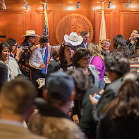 011315       Cable Hoover<br /> <br /> A crowd packs the state room at the office of the Navajo Nation president for the swearing-in of Ben Shelley and Rex Lee Jim Tuesday in Window Rock.