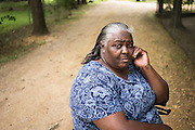 """HAYNEVILLE, AL – MAY 21, 2015: Charlie Mae Martin Holcombe, 66, moved to her current home in Hayneville in 1984, where the sewage from a lagoon across the street regularly backs up into her front yard. """"This whole area floods, all over the yard,"""" she said. """"You can count the few times that this ditch is dry."""" Inadequate sewage treatment has plagued Alabama's poor Black Belt community for decades, often leading to problems of overflow and contamination of the area's water supply."""