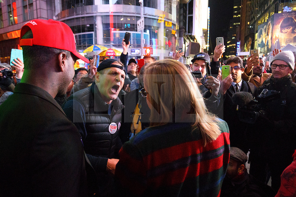 © Licensed to London News Pictures. 09/11/2016. New York CIty, USA. Pro-Trump supporters argue with pro-Clinton supporters as they react to news that Donald Trump is elected as the next president of the United States, while gathering in Times Square, New York City, on Wednesday, 9 November. Photo credit: Tolga Akmen/LNP