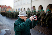 About 10000 Czech citizens accompanied the body of Vaclav Havel from the Old Town part in Prague across Charles Bridge   up to Prague Castle, the seat of Czech presidents. Man taking a photograph of soldiers attending the mourning procession for former President Vaclav Havel at the Prague Castle.