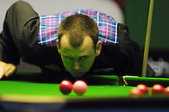 Mark Williams of Wales lines up a shot during the Welsh Open Snooker tournament at the Newport Centre in Newport,South Wales.