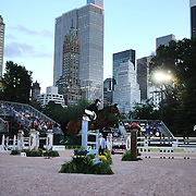 Catherine Pasmore, USA, riding Bonanza Van Paemel, in action during the $210,000 Central Park Show Jumping Grand Prix held in the Wollman Ice Rink. The event was part of the four Day Central Park Horse Show. Central Park, Manhattan, New York, USA. 18th September 2014. Photo Tim Clayton