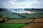 Stubble burning in fields Somerset, England, UK a farming practice prohibited since 1993 because smoke caused atmospheric pollution