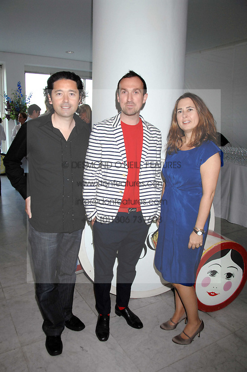 Left to right, BRYAN MEEHN of Nude, photographer TIM WALKER and editor of Vogue ALEXANDRA SHULMAN at a reception hosted by Vogue magazine to launch photographer Tim Walker's book 'Pictures' sponsored by Nude, held at The Design Museum, Shad Thames, London SE1 on 8th May 2008.<br /><br />NON EXCLUSIVE - WORLD RIGHTS
