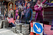 During the UKs Coronavirus pandemic lockdown and in the 24hrs when a further 255 deaths occurred, bringing the official covid deaths to 37,048, <br /> pavement works materials and barriers are next to the characters of many musical productions outside the Sondheim Theatre in Shaftesbury Avenue, still closed as per governmental rules, on 26th May 2020, in London, England. Theatres and other entertainment venues will be some of the last businesses to re-open as the UK pandemic lockdown improves and many theatres are already close to financial collapse. Lockdown has allowed some roadworks and construction to continue unhindered.