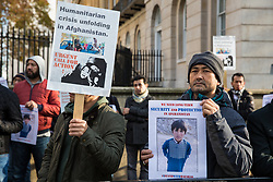 London, UK. 21st November, 2018. Members of the Hazara community, an ethnic group native to the region of Hazarajat in central Afghanistan, protest opposite Downing Street against a lack of assistance from the Afghan government in the face of attacks by the Taliban and Islamic State.