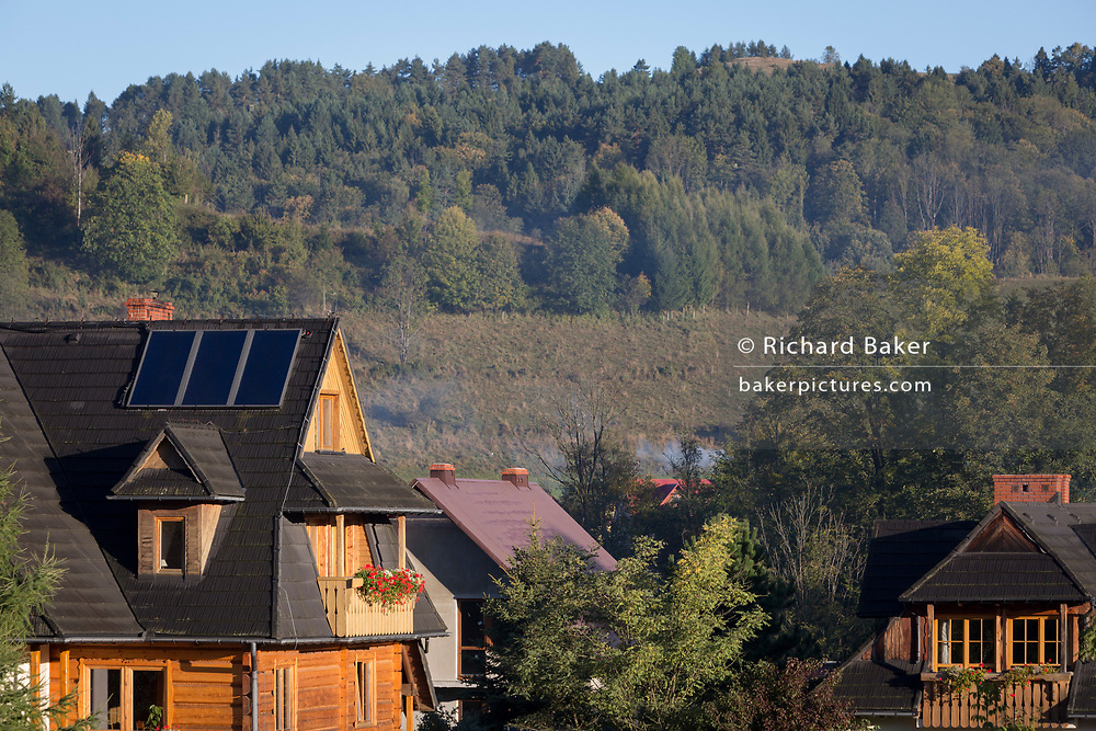 Solar panels on a local Polish country wood-constructed home, on 22nd September 2019, in Jaworki, near Szczawnica, Malopolska, Poland. Local wealth has encouraged tourism appartments and short-stay properties in southern Poland mountain region, a very popular outdoor activity destination for city-dwelling Poles but at the cost of the local environment and landscape.
