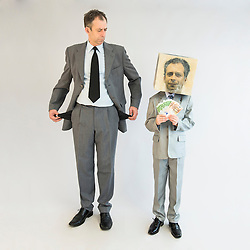 Businessman holding empty pockets and boy wearing mask showing banknotes