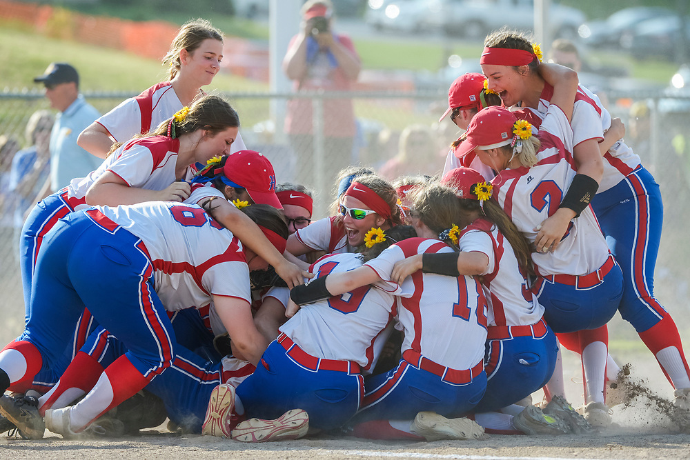 The Herbert Hoover Huskies celebrate their victory over the Petersburg Vikings in the Class AA  state softball championship at Jackson Memorial Park in Vienna, W.Va., on Thursday, May 23, 2019.
