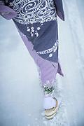 Woman wearing kimono walking in snow in Shirakawa-go, Japan