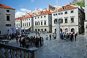 Groups of tourists in Luza (Loza) Square, Dubrovnik old town, Croatia
