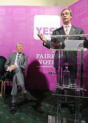 © licensed to London News Pictures. LONDON UK. 27/04/11. Alan Johnson (L) listens to Nigel Farage (R). A News conference held today (27 April 2011) in Church House, London. The conference was introduced by Katie Ghose with Lib Dem President Tim Farron, Green Party Leader Caroline Lucas, UKIP leader Nigel Farage and  Labour's  Alan Johnson, supporting a Yes for the Alternative Vote. Photo credit should read Stephen Simpson/LNP