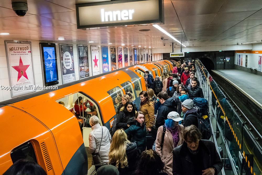 View of subway train and passengers at subway station platform on the Glasgow Subway system , Scotland, United Kingdom
