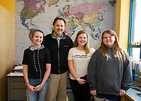 """Madelyn Young, Mayor Ed Engler, Cali Andriski and Riley Clark-Patten during Whitney McCallum's 6th grade """"genius hour"""" where the students presented possilbe solutions to city problems posed by Mayor Engler.  (Karen Bobotas/for the Laconia Daily Sun)"""