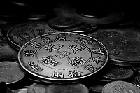 Closeup image of a pile of old chinese coins.
