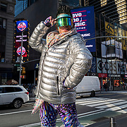 A man wearing bright clothing poses in Times Square for the Holiday season during the Coronavirus (Covid-19) outbreak in Manhattan,New York on Sunday, December 6, 2020. (Alex Menendez via AP)