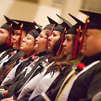 121712       Brian Leddy<br /> Graduates of Navajo Technical College's Registered Nursing Program listen to a speech at commencement Monday morning. The group was the first class to graduate from the school with a nursing degree.