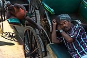 Rickshaw wallahs napping in the muslim neighborhood around the Nakhoda Mosque.