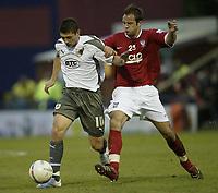 Photo: Aidan Ellis.<br /> York City v Bristol City. The FA Cup. 11/11/2006.<br /> Bristol's Phil Jevons (L) battles with York's Luke Foster