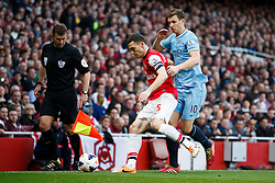 Arsenal Defender Thomas Vermaelen (BEL) is challenged by Man City Forward Edin Dzeko (BIH) - Photo mandatory by-line: Rogan Thomson/JMP - 07966 386802 - 29/03/14 - SPORT - FOOTBALL - Emirates Stadium, London - Arsenal v Manchester City - Barclays Premier League.