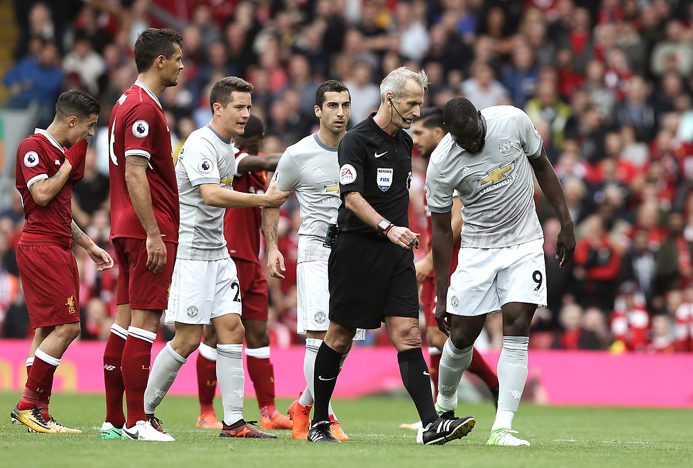 Referee Martin Atkinson has words with Manchester United's Romelu Lukaku following his foul on Liverpool's Joe Gomez<br /> <br /> Photographer Rich Linley/CameraSport<br /> <br /> The Premier League - Liverpool v Manchester United - Saturday 14th October 2017 - Anfield - Liverpool<br /> <br /> World Copyright © 2017 CameraSport. All rights reserved. 43 Linden Ave. Countesthorpe. Leicester. England. LE8 5PG - Tel: +44 (0) 116 277 4147 - admin@camerasport.com - www.camerasport.com