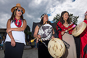 Paddlers from the native Canoe Journey are welcomed to Port Angeles' beach by the Lower Elwha Tribe singers and drummers. 78 canoes participated, joining each other as tribes entered the route along the way, and included representatives from tribes as far away as Montana and even New Zealand.<br /> <br /> The various canoe routes are from both sides of Vancouver Island, Georgia Strait, and the Olympic Peninsula.<br /> <br /> All the canoes are hand carved dugouts. Many carry tribal talismans, or have other hand made decorations that carry meaning for the tribal members.