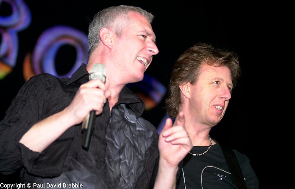 Thunder lead singer Danny Bowes and Bass Guitarist Chris Childs onstage at the Monsters of Rock Festival. Last night of an eleven date tour at the Hallam FM Arena, Sheffield Tuesday 26th November 2002<br /> <br /> Copyright Paul David Drabble<br /> Freelance Photographer<br /> 07831 853913<br /> 0114 2468406<br /> www.pauldaviddrabble.co.uk<br /> [#Beginning of Shooting Data Section]<br /> Nikon D1 <br /> 2002/11/26 20:13:58.4<br /> JPEG (8-bit) Fine<br /> Image Size:  2000 x 1312<br /> Color<br /> Lens: 80-200mm f/2.8-2.8<br /> Focal Length: 135mm<br /> Exposure Mode: Manual<br /> Metering Mode: Spot<br /> 1/250 sec - f/2.8<br /> Exposure Comp.: 0 EV<br /> Sensitivity: ISO 400<br /> White Balance: Auto<br /> AF Mode: AF-S<br /> Tone Comp: Normal<br /> Flash Sync Mode: Front Curtain<br /> Auto Flash Mode: External<br /> Color Mode: <br /> Hue Adjustment: <br /> Sharpening: Normal<br /> Noise Reduction: <br /> Image Comment: <br /> [#End of Shooting Data Section]