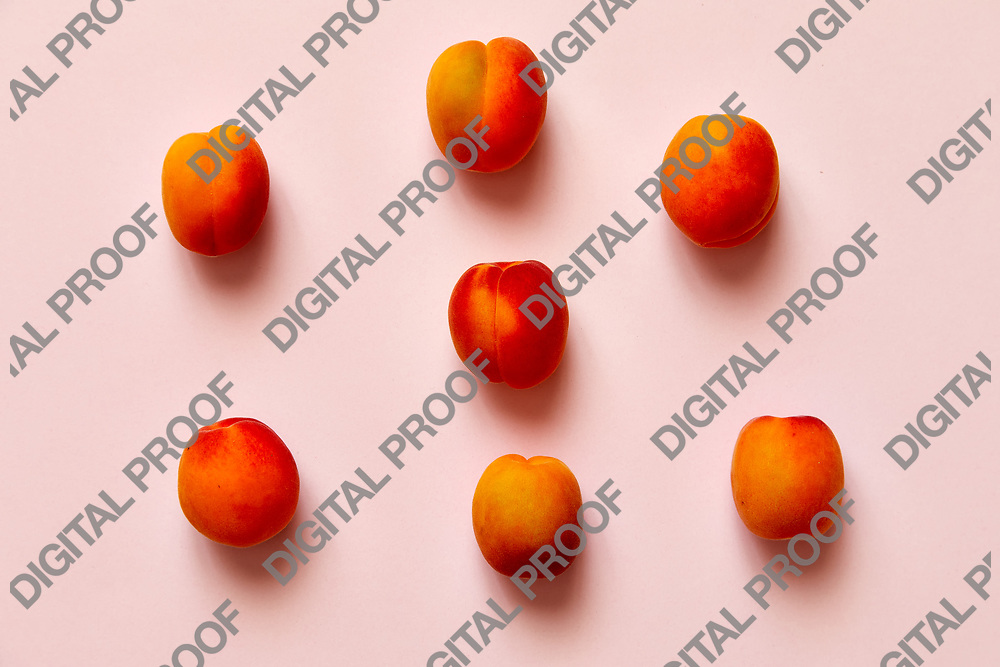 Apricots set of six  isolated over a pink background viewed from above, flatlay style