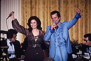 """Loretta Lynn and Conway Twitty in the East Room of the White House as part of an """"In performance at the White House"""" in April 1978<br /> Photo by Dennis Brack"""