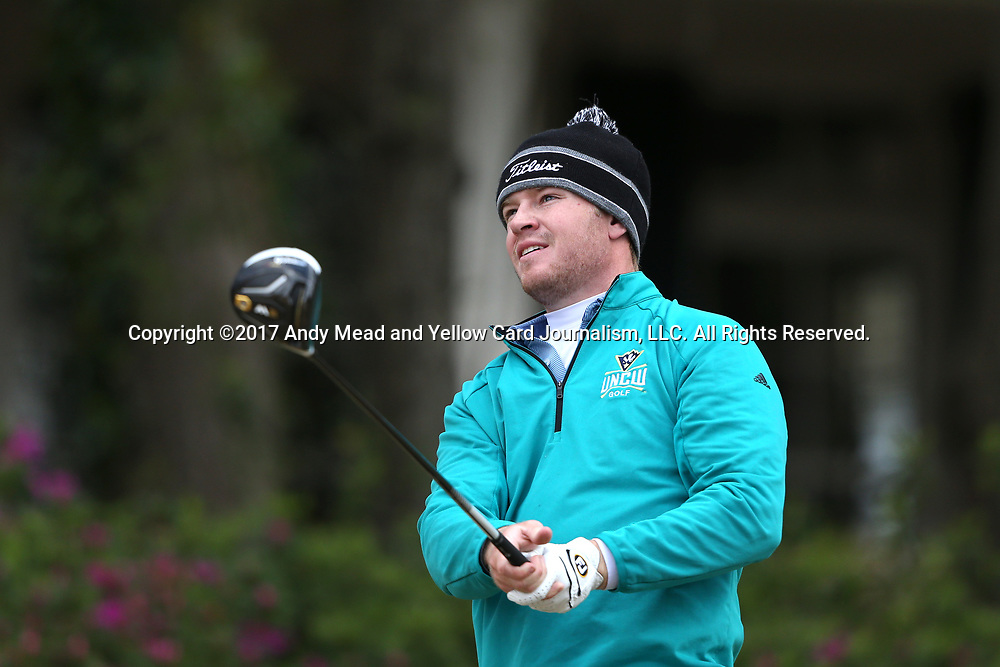 WILMINGTON, NC - MARCH 19: UNC Wilmington's Thomas Lilly tees off on the Ocean Course seventh hole. The first round of the 2017 Seahawk Intercollegiate Men's Golf Tournament was held on March 19, 2017, at the Country Club of Landover Nicklaus Course in Wilmington, NC.
