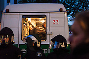 """01/05/2015 – Berlin, Germany: A members of the Radical Left is held on a police van after being detained for disturbance after the """"Revolutionary 1st of May Demonstrations"""" in Kreuzberg. Every year radical groups create disorder which leads the authorities to make several arrests. The International Workers Day is a celebration of laborers and the working classes that is promoted by the international labor movement, anarchists, socialists, and communists and occurs every year on May Day. (Eduardo Leal)"""