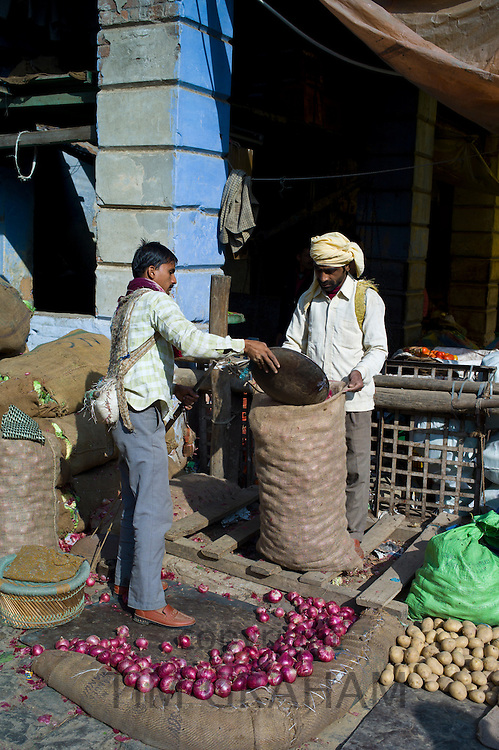 Old Delhi, Daryagang fruit and vegetable market with red onions and potatoes on sale, India