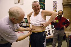 Man being measured at slimmers club,