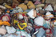 China, Central Tibet, various Buddhist offerings, beads, tsa tsa etc.
