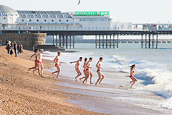 © Licensed to London News Pictures. 16/12/2017. Brighton, UK. Members of the public brave the cold water to go for a quick swim in the Brighton and Hove sea. Photo credit: Hugo Michiels/LNP