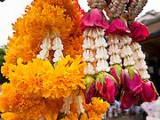 24 JUNE 2011 - CHIANG MAI, THAILAND: Flower garlands for sale in the flower market in Chiang Mai, Thailand.  PHOTO BY JACK KURTZ