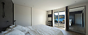 Interior of house, comfortable bedroom, view from the bed