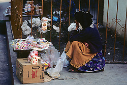 Woman Selling Cigarettes and Other Goods on Street
